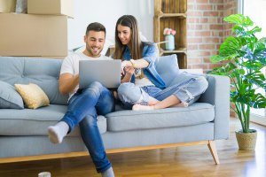 Couple on couch looking up information on erectile dysfunction.