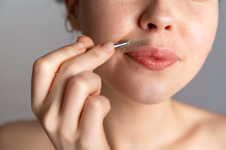 Upper lip hair on a woman