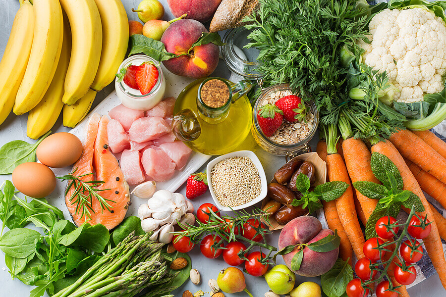 Tabletop with healthy fruits and vegetables.