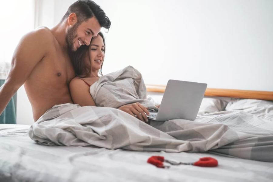 Smiling couple lying together