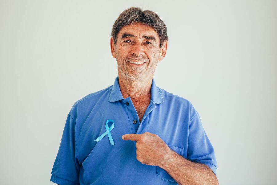Older man with prostate cancer ribbon
