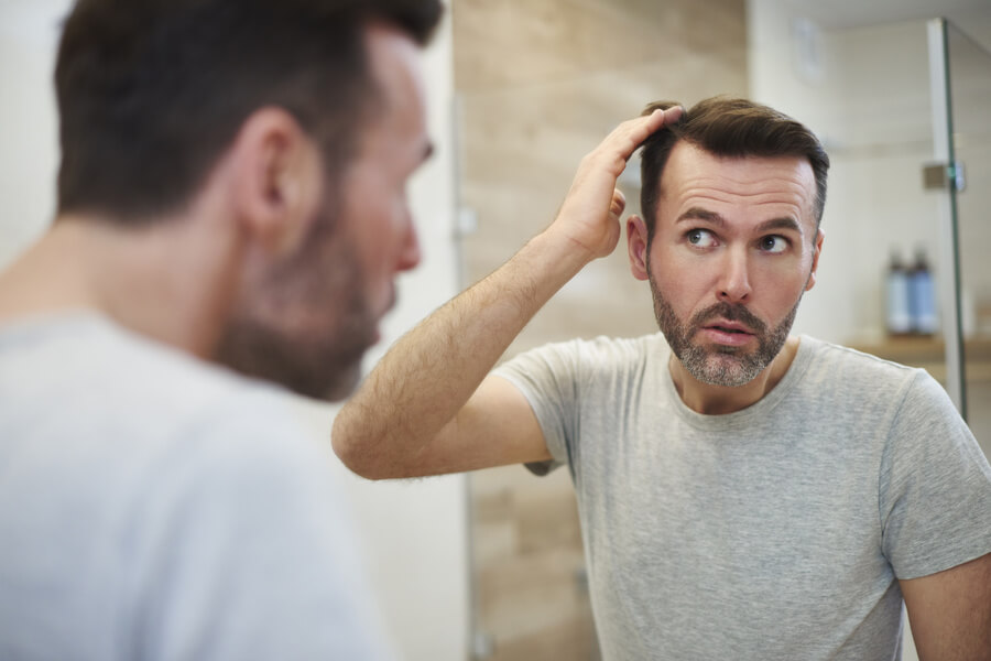Man checking his hairline