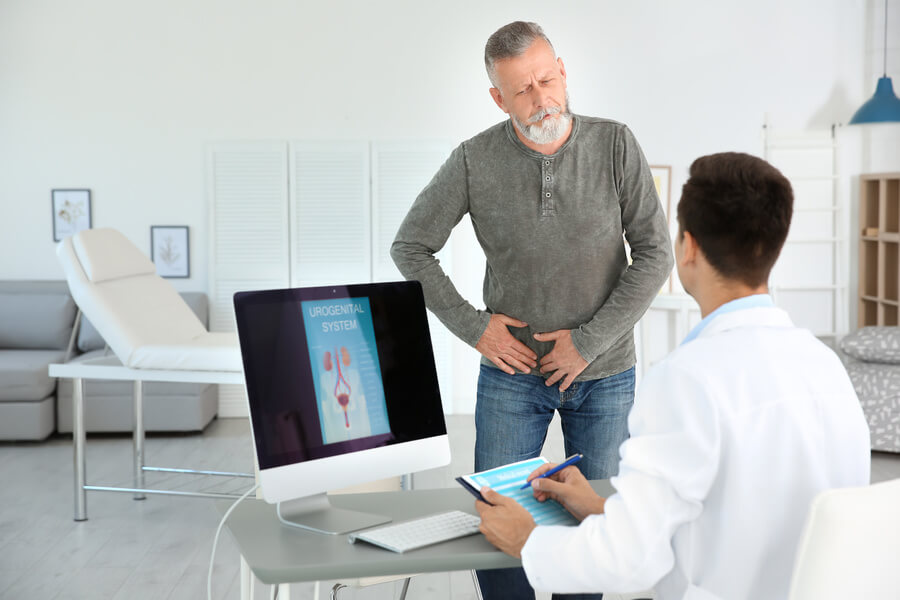 Man holding his groin in discomfort
