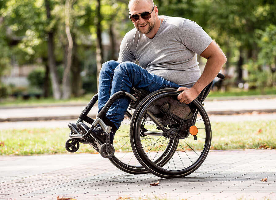 Man Doing Wheelie in a Wheelchair